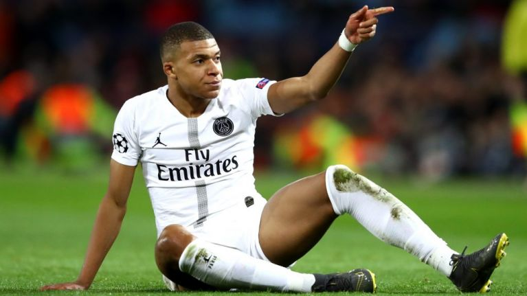 Mbappe creates record as Paris extend lead